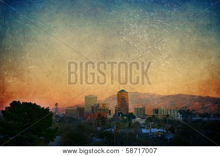 Tucson cityscape at sunset with a texture overlay