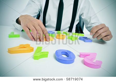 a businessman sitting in a desk forming the number 2014, as the new year