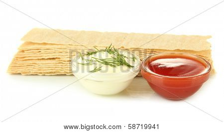 Potato chips and sauces, isolated on white