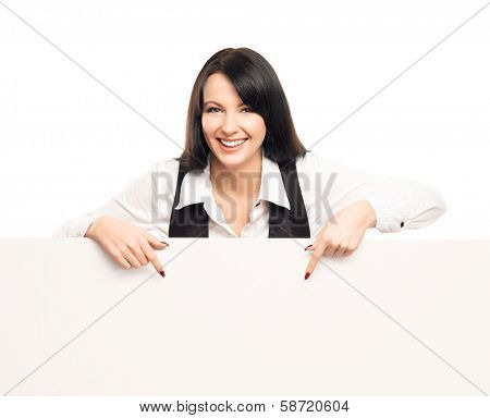 Young, confident, successful and beautiful business woman with the blank billboard isolated on white