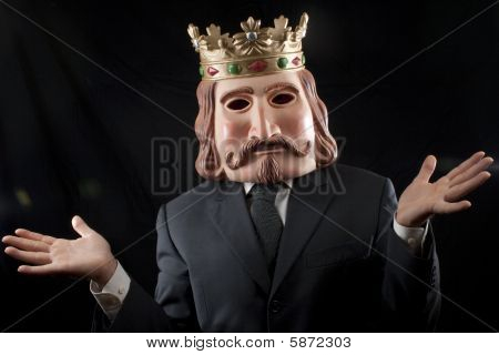 Businessman with king mask surprised, isolated on black