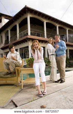 Parents dancing, children amused
