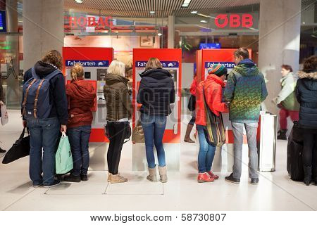 People On A Ticket Machine