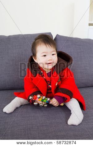 Little girl playing toy