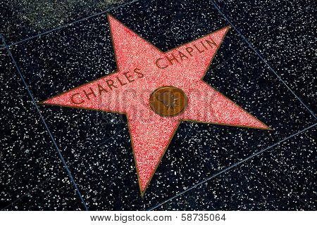HOLLYWOOD, CALIFORNIA - APRIL 12, 2013:Charles Chaplin Star on Hollywood Walk of Fame in Hollywood California on April 2013. Red star is one of the 2400 celebrity stars located on Hollywood Boulevard.