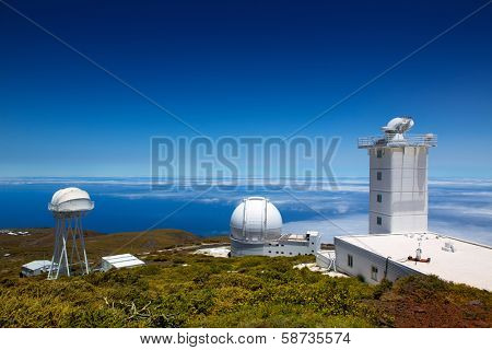 LA PALMA, CANARY ISLANDS, SPAIN - JULY 13, 2012: William Herschel telescope in a sunny day blue sky in ORM observatory by IAC institute at Roque de los Muchachos in La Palma, Canary, Spain, July 2012.