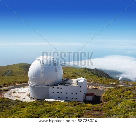 LA PALMA, CANARY ISLANDS, SPAIN - JULY 14, 2012: William Herschel telescope in a sunny day blue sky in ORM observatory by IAC institute at Roque de los Muchachos in La Palma, Canary, Spain, July 2012.