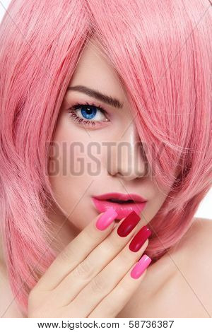 Close-up portrait of young beautiful girl with pink hair and fancy manicure