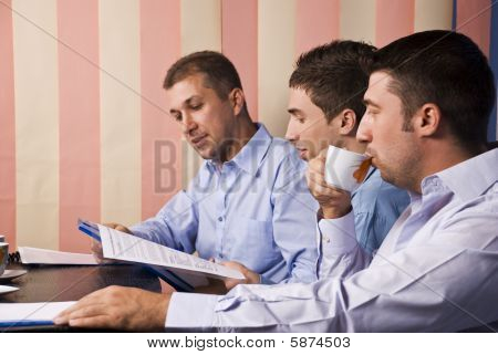 Businessmen In Office Working