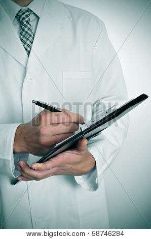 a doctor writing in a clipboard