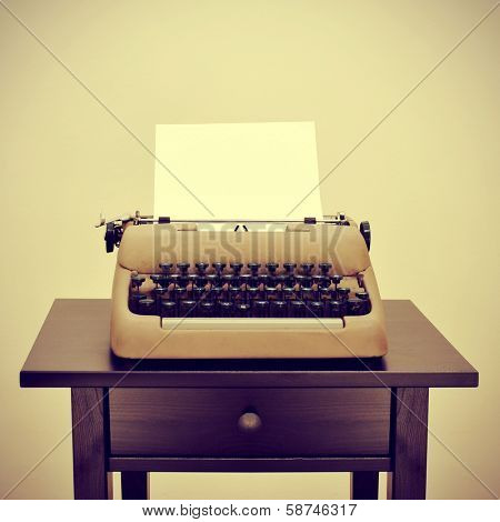 an old typewriter with a blank page on a desk, with a retro effect