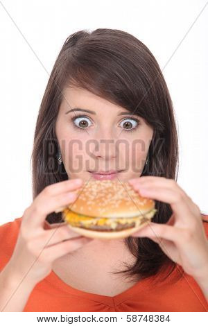 Brunette girl eating Burger