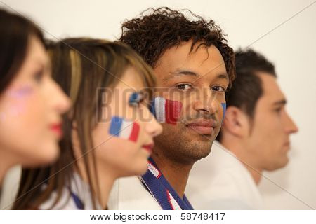 Four French sports fans stood in anticipation