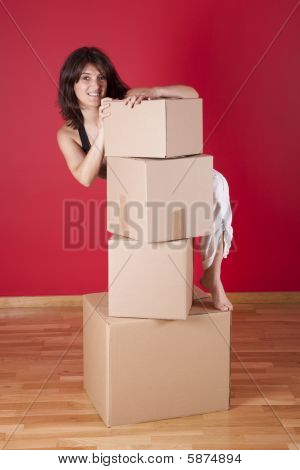 Woman Holding Cardboard Boxes