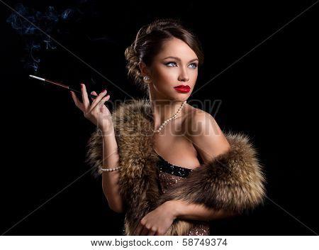 Vintage, retro. Gorgeous woman with a cigarette