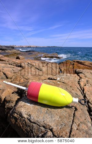 Lobster Trap Buoy On Ocean Shore Rock