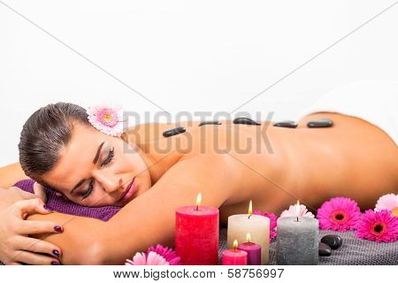 Young Attractive Woman Hot Stone Massage Wellness
