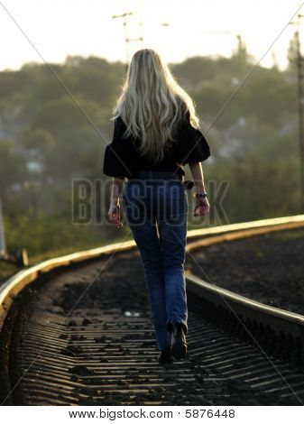 Young Woman Walking By Railway