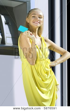 Happy Woman With Plastic Card