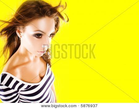 Pretty Young Woman Posing On Yellow Background