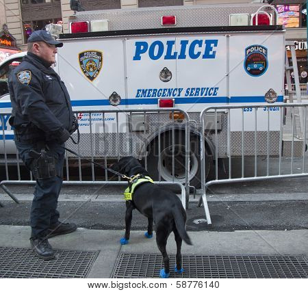 NYPD transit bureau K-9 police officer and K-9 dog providing security on Times Square