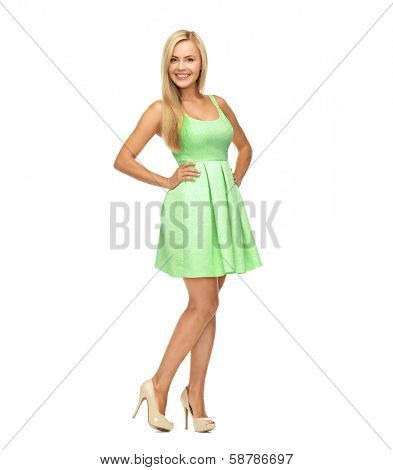 beauty, fashion and happy people concept - young woman in green dress and high heels