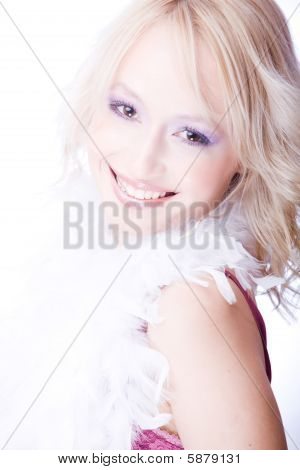 smiling young woman with boa over her neck isolated on white