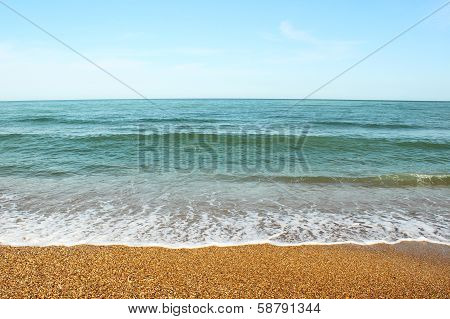 Pebble beach and sea wave