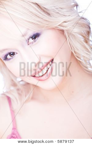 portrait of smiling young blond woma