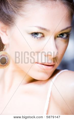 portrait of attractive young attractive woman with mysterious look