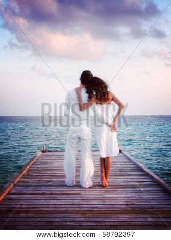 Sensual love couple on a jetty on Maldives