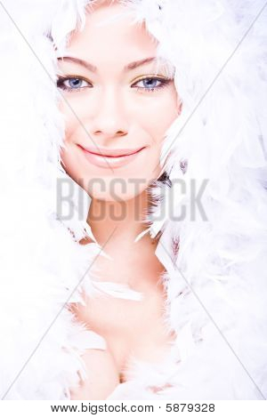 young woman with white downy boa over her head