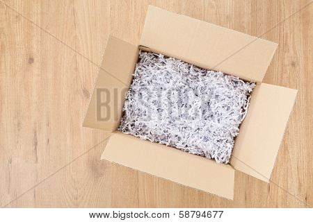 Open Box Or Parcel On The Floor