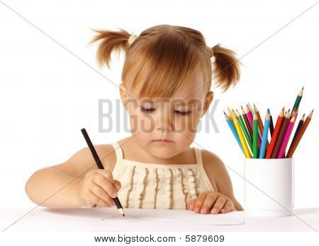 Cute Preschooler Focused On Drawing