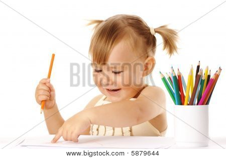 Happy Child Points On Her Drawing And Smile