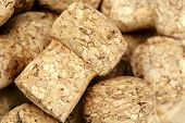 picture of sparkling wine  - Sparkling wine bottle cork shown close up against background to other corks - JPG