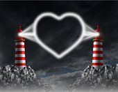 stock photo of long distance relationship  - Relationship communication and love guide concept with two lighthouses shining a beacon light shaped as a romantic heart icon of togetherness on a night sky - JPG