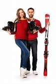stock photo of ski boots  - Two young people stand with skiing and ski boots - JPG