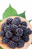 Blackberries On Wooden Plate
