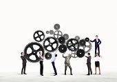 stock photo of mechanical engineer  - Conceptual image of businessteam working cohesively - JPG