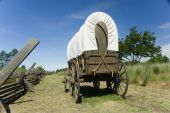 stock photo of covered wagon  - Covered wagon on portion of original Oregon trail at Whitman Mission in Washington state - JPG