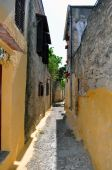 Narrow street in the medieval town of Rhodes. poster