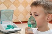stock photo of inhalant  - inhalation of medication through the boy for health - JPG