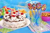 image of torte  - chocolate spoons with colorful sprinkles and torte with candles for children birthday party - JPG