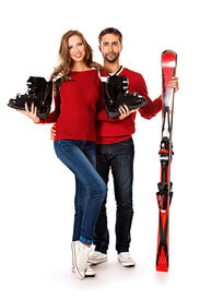 image of ski boots  - Two young people stand with skiing and ski boots - JPG