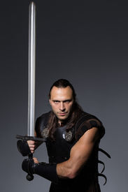 pic of longsword  - Young man has some dangerous hobby - JPG