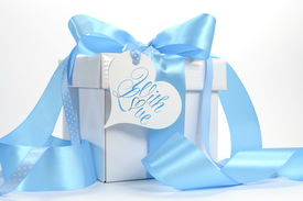 stock photo of christening  - Beautiful pale aqua baby blue gift with love gift heart shape gift tag on blue and white background with copy space for Fathers Day Baby Boy shower or christening or masculine birthday wedding or shower present - JPG