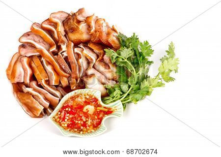 Piece Of Grill Ear's Pork With Sauce