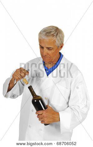 Sommelier uncorking a bottle of wine