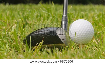 Golf ball on a tee with #3 wood,